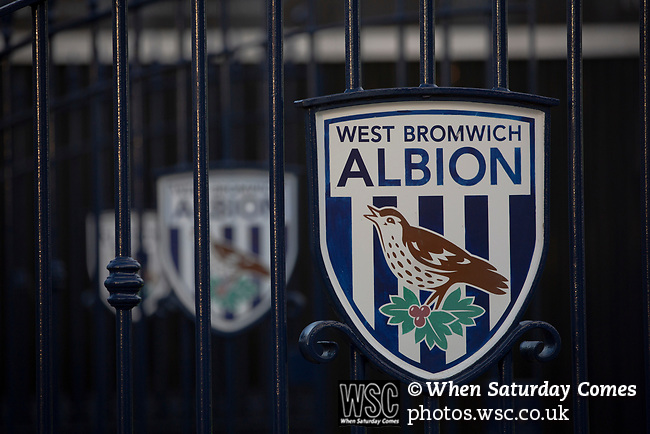 Club crests on the entrance gates to the stadium, pictured before West Bromwich Albion take on Leeds United in a SkyBet Championship fixture at the Hawthorns. Formed in 1878, the home team were relegated from the English Premier League the previous season and were aiming to close the gap on the visitors at the top of the table. Albion won the match 4-1 watched by a near-capacity crowd of 25,661.