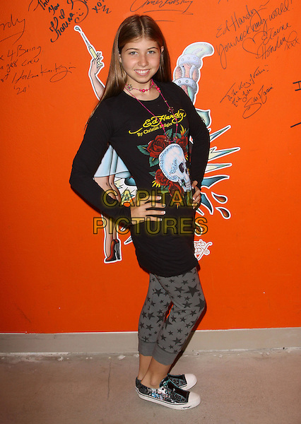 MICHAELA CARROZZO.Celebrities Visits the Ed Hardy Outlets held At Ed Hardy Headquarters, Culver City, California, USA..September 30th, 2009.full length grey gray stars pattern print leggings black top hand on hip.CAP/ADM/KB.©Kevan Brooks/AdMedia/Capital Pictures.