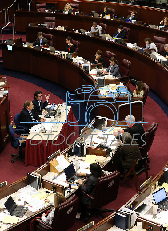 Nevada Gov. Brian Sandoval's Chief of Staff Mike Willden, center left, and Economist Jeremy Aguero testify in an Assembly Committee of the Whole hearing at the Legislative Building in Carson City, Nev., on Saturday, May 30, 2015. <br /> Photo by Cathleen Allison