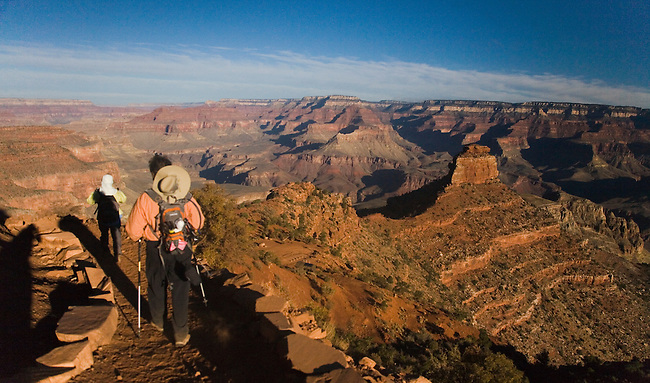 A PAIR OF HIKERS DESCENDING THE SOUTH KAIBAB TRAIL ON THE WAY TO THE COLORADO RIVER AT GRAND CANYON NATIONAL PARK, ARIZONA