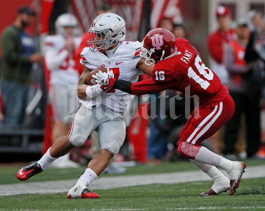 Ohio State Buckeyes running back Jalin Marshall (7)begins the have the ball stripped away by Indiana Hoosiers defensive back Rashard Fant (16) in the third quarter of the Ohio State Buckeyes against the Indiana Hoosier at Memorial Stadium in Bloomington Indiana Oct. 3, 2015.(Dispatch photo by Eric Albrecht)