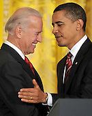Washington, DC - January 30, 2009 -- United States President Barack Obama, right, and Vice President Joseph Biden, left, shake hands after announcing Labor Executive Orders and the establshment of the Middle Class Working Families Task Force in the East Room of the White House in Washington, DC on Friday, January 30, 2009.  .Credit: Ron Sachs - CNP