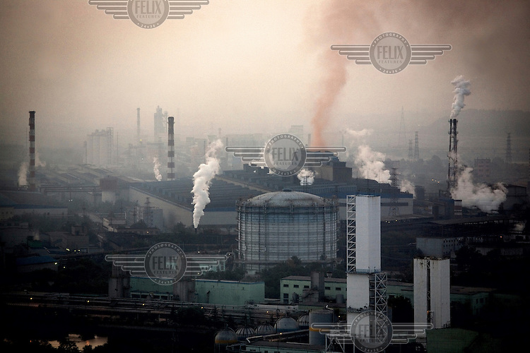 Chemical smoke billows out of the Shougang factory in Beijing, one of the most air-polluted cities on earth..