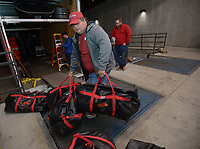 NWA Democrat-Gazette/ANDY SHUPE<br />Rodney Collins of Pensacola, Fla., loads equipment Thursday, Nov. 9, 2017, into a 53-foot semi-trailer before heading out to Baton Rouge, La., ahead of the Razorbacks' game with LSU Saturday. Collins and co-worker Jerry Rico of Fayetteville are employees of J.B. Hunt Transport and the work together to drive equipment necessary for the Razorbacks football team to and from games away from Fayetteville.