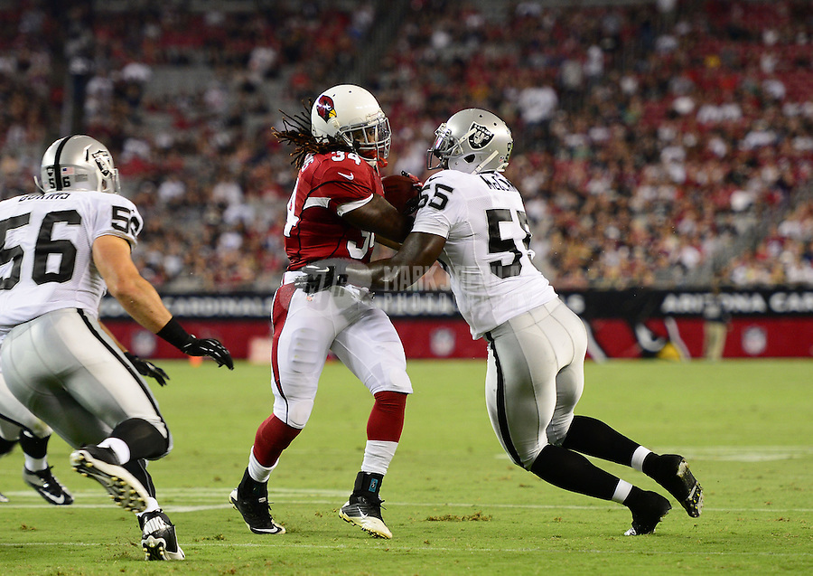 Aug. 17, 2012; Glendale, AZ, USA; Arizona Cardinals running back (34) Ryan Williams is tackled by Oakland Raiders linebacker (55) Rolando McClain in the first quarter during a preseason game at University of Phoenix Stadium. The Cardinals defeated the Raiders 31-27. Mandatory Credit: Mark J. Rebilas-