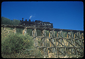 Leased D&amp;RGW #452 crossing RGS Bridge 57-B, the Lower Gallagher Trestle, southbound.<br /> RGS  Gallagher, CO  Taken by Kindig, Richard H. - 9/4/1951