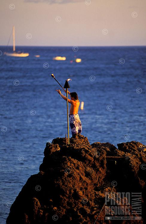 A tiki torch lighting ceremony at sunset, Kaanapali, Maui