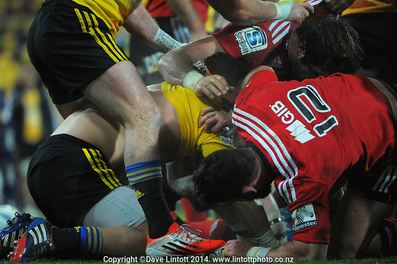 TJ Peranara gets buried during the Super Rugby match between the Hurricanes and Crusaders at Westpac Stadium, Wellington, New Zealand on Saturday, 28 June 2014. Photo: Dave Lintott / lintottphoto.co.nz