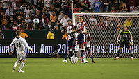 LA Galaxy midfielder David Beckham (23) takes a free kick over a Chivas wall of midfielder Jessie Marsch (15) and forward Mykel Galindo (11) as Chivas goalkeeper Brad Guzan (18) looks on. CD Chivas USA defeated the LA Galaxy 3-0 in the Super Classico MLS match at the Home Depot Center in Carson, California, Thursday, August 23, 2007.