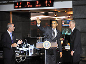 McLean, VA - October 6, 2009 -- United States President Barack Obama waves to employees after making remarks during a visit to the National Counterterrorism Center (NCTC) in McLean, VA on Tuesday, October 6, 2009.  With Obama are Michael Leiter, Director, National Counterterrorism Center, left, and Dennis Blair, Director of National Intelligence, right..Credit: Ron Sachs / Pool via CNP