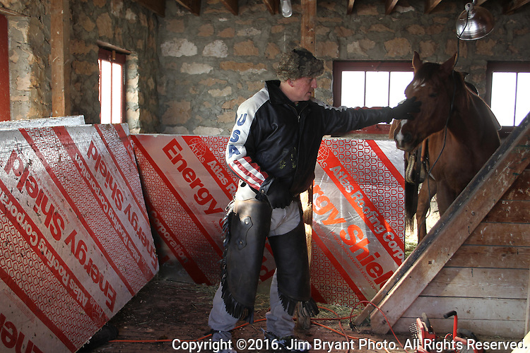 Duane Ehmer, of Irrigon, Oregon, gives his horse, Hellboy, a pat at the Malheur National Wildlife Reserve on January 15, 2016 in Burns, Oregon. Ehmer has been pulling sentry duty during the takeover. Ammon Bundy and about 20 other protesters took over the refuge on Jan. 2 after a rally to support the imprisoned local ranchers Dwight Hammond Jr., and his son, Steven Hammond.  ©2016. Jim Bryant Photo. All Rights Reserved.