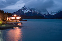 The Hosteria Pehoe glows on the shores of a small island in Pehoe Lake at Torres del Paine National Park in southern Chile. A half dozen small hotels where guests can stay within constant sight of stunning vistas dot the park. (Kevin Moloney for the New York Times)