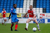 Paddy Madden of Fleetwood Town closes down Anthony Grant of Peterborough United during the Sky Bet League 1 match between Peterborough and Fleetwood Town at London Road, Peterborough, England on 28 April 2018. Photo by Carlton Myrie.