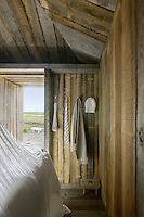 A simple shower is accessed through the sleeping cabin and has views over the estuary