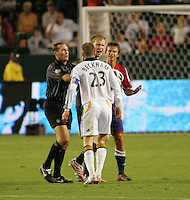 LA Galaxy midfielder David Beckham (23) argues with Chivas midfielder Jessie Marsch (15) and goalkeeper Brad Guzan (18). CD Chivas USA defeated the LA Galaxy 3-0 in the Super Classico MLS match at the Home Depot Center in Carson, California, Thursday, August 23, 2007.