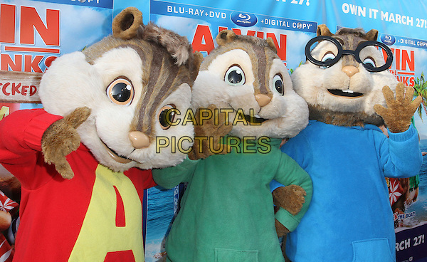"""Alvin And The Chipmunks.The Twentieth Century Fox Home Entertainment's """"Alvin And The Chipmunks: Chipwrecked"""" Blu-ray And DVD Release Party Held At The El Rey Theatre, Los Angeles, California, USA..March 26th, 2012.half length simon theodore red green blue costume glasses .CAP/ADM/FS.©Faye Sadou/AdMedia/Capital Pictures."""