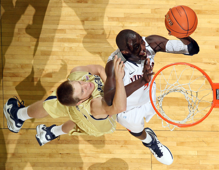 Jan. 22, 2011; Charlottesville, VA, USA; Virginia Cavaliers center Assane Sene (5) shoots in front of Georgia Tech Yellow Jackets center Nate Hicks (42) during the game at the John Paul Jones Arena. Virginia won 72-64. Mandatory Credit: Andrew Shurtleff-US PRESSWIRE