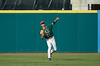 Greensboro Grasshoppers center fielder Connor Scott (23) throws the ball back to the infield during the game against the West Virginia Power at First National Bank Field on August 9, 2018 in Greensboro, North Carolina. The Power defeated the Grasshoppers 5-3 in game one of a double-header. (Brian Westerholt/Four Seam Images)