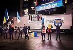 Solna 2014-10-09 Fotboll EM-kval , Sverige - Ryssland :  <br /> Personer med Ukrainaflaggor och ett plakat med texten &quot;Red Card Putin&quot; protesterar mot att Ryssland arrangerar VM 2018 utanf&ouml;r Friends Arena innan matchen mellan Sverige och Ryssland<br /> (Photo: Kenta J&ouml;nsson) Keywords:  Sweden Sverige Friends Arena EM Kval EM-kval UEFA Euro European 2016 Qualifier Qualifiers Qualifying Group Grupp G Ryssland Russia supporter fans publik supporters