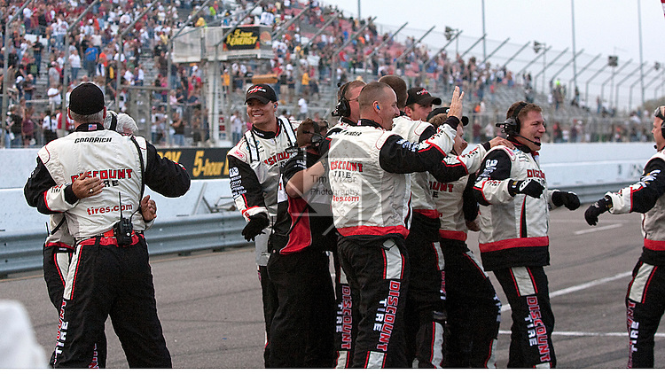 102310tvpitcrewhappy.The pit crew of winner Brad Keselowski celebrates after he won the 5 Hour Energy 250 Race at Gateway International Raceway, a NASCAR Nationwide Race, on Satuday October 23, 2010..TIM VIZER/BELLEVILLE NEWS-DEMOCRAT/THE ASSOCIATED PRESS