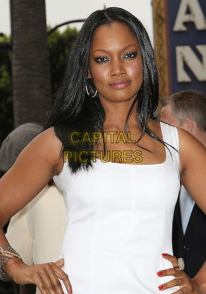 Garcelle Beauvais.Malcolm McDowell Hollywood Walk of Fame Star Ceremony, Hollywood, California, USA..March 16th, 2012.half length white dress hands on hips.CAP/ADM/KB.©Kevan Brooks/AdMedia/Capital Pictures.