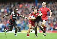 Wales's William Harries is tackled by Kenya's Lamech Billy Odhiambo<br /> <br /> Kenya Vs Wales - men's placing 5-8 match<br /> <br /> Photographer Chris Vaughan/CameraSport<br /> <br /> 20th Commonwealth Games - Day 4 - Sunday 27th July 2014 - Rugby Sevens - Ibrox Stadium - Glasgow - UK<br /> <br /> © CameraSport - 43 Linden Ave. Countesthorpe. Leicester. England. LE8 5PG - Tel: +44 (0) 116 277 4147 - admin@camerasport.com - www.camerasport.com