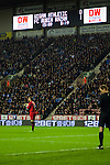 Wigan Athletic 1 Rubin Kazan 1, 24/10/2013. DW Stadium, Europa League Group D. Wigan Athletic embark on their first European campaign having won the FA Cup the previous season. The DW Stadium is temporarily known as The Wigan Athletic Stadium for Europa League fixtures. Scott Carson and the fourth official with the scoreboard. Photo by Paul Thompson.