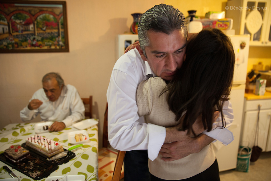 """Donovan hugs his wife Alicia while celebrating his 43rd birthday at his home in Texcoco, Mexico on May 9, 2015. Donovan Tavera, 43, is the director of """"Limpieza Forense México"""", the country's first and so far the only government-accredited forensic cleaning company. Since 2000, Tavera, a self-taught forensic technician, and his family have offered services to clean up homicides, unattended death, suicides, the homes of compulsive hoarders and houses destroyed by fire or flooding. Despite rising violence that has left 70,000 people dead and 23,000 disappeared since 2006, Mexico has only one certified forensic cleaner. As a consequence, the biological hazards associated with crime scenes are going unchecked all around the country. Photo by Bénédicte Desrus"""