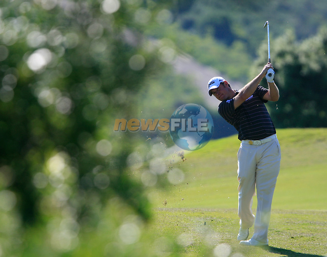 Lee Westwood (ENG) plays his 2nd shot on the 7th hole during the morning session on Day 3 of the Volvo World Match Play Championship in Finca Cortesin, Casares, Spain, 21st May 2011. (Photo Eoin Clarke/Golffile 2011)