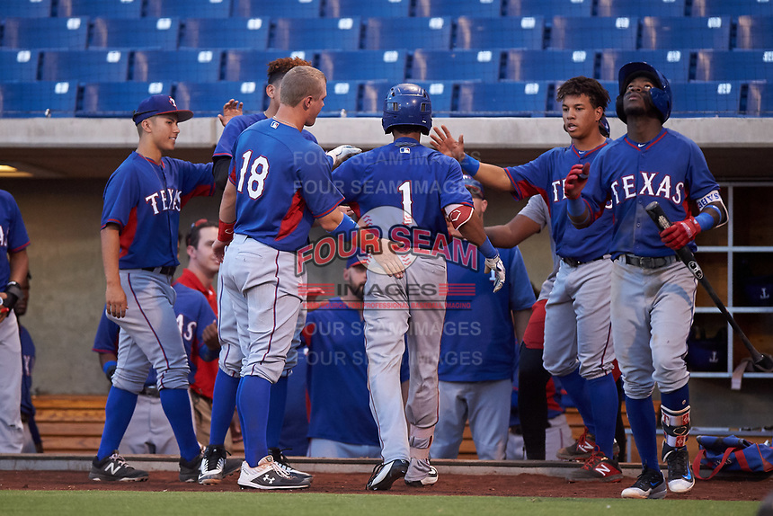 AZL Rangers Randy Florentino (1) is congratulated by teammates after hitting a home run during an Arizona League game against the AZL Brewers Blue on July 11, 2019 at American Family Fields of Phoenix in Phoenix, Arizona. The AZL Rangers defeated the AZL Brewers Blue 5-2. (Zachary Lucy/Four Seam Images)
