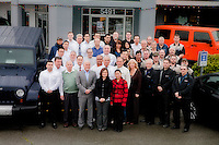 All the staff group pose for photos in various departments and groups