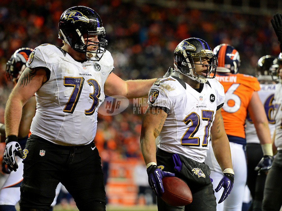 Jan 12, 2013; Denver, CO, USA; Baltimore Ravens running back Ray Rice (27) celebrates a touchdown with guard Marshal Yanda (73) against the Denver Broncos during the AFC divisional round playoff game at Sports Authority Field.  Mandatory Credit: Mark J. Rebilas-