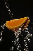 Stock photo of orange being washed