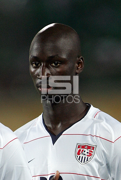 The United States' Ike Opara (16) stands for the American National Anthem before the game against Cameroon before the FIFA Under 20 World Cup Group C Match between the United States and Cameroon at the Mubarak Stadium on September 29, 2009 in Suez, Egypt.
