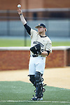Wake Forest Demon Deacons bullpen catcher Chris Shafer (25) warms up the starting pitcher prior to the game against the Liberty Flames at David F. Couch Ballpark on April 25, 2018 in  Winston-Salem, North Carolina.  The Demon Deacons defeated the Flames 8-7.  (Brian Westerholt/Sports On Film)