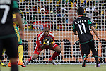 11 JUN 2010: Itumeleng Khune (RSA) (in red) gathers the ball in front of Carlos Vela (MEX) (11). The South Africa National Team tied the Mexico National Team 1-1 at Soccer City Stadium in Johannesburg, South Africa in the opening match of the 2010 FIFA World Cup.