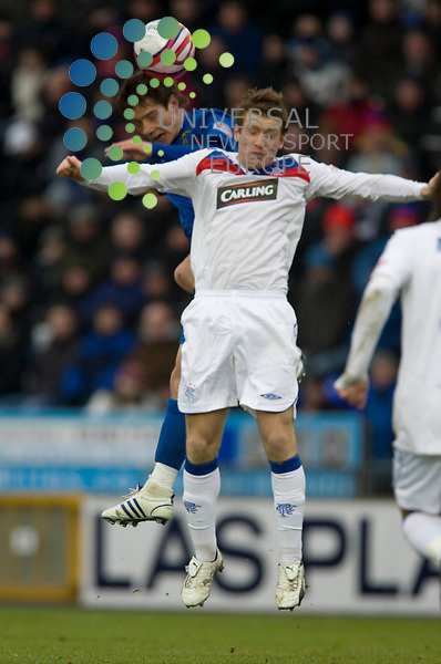 FOOTBALL.Scottish Premier League.Inverness CT v Rangers.Pictured is .Inverness player (red/blue) Ian Black outjumps.Rangers player (white) Steven Davis