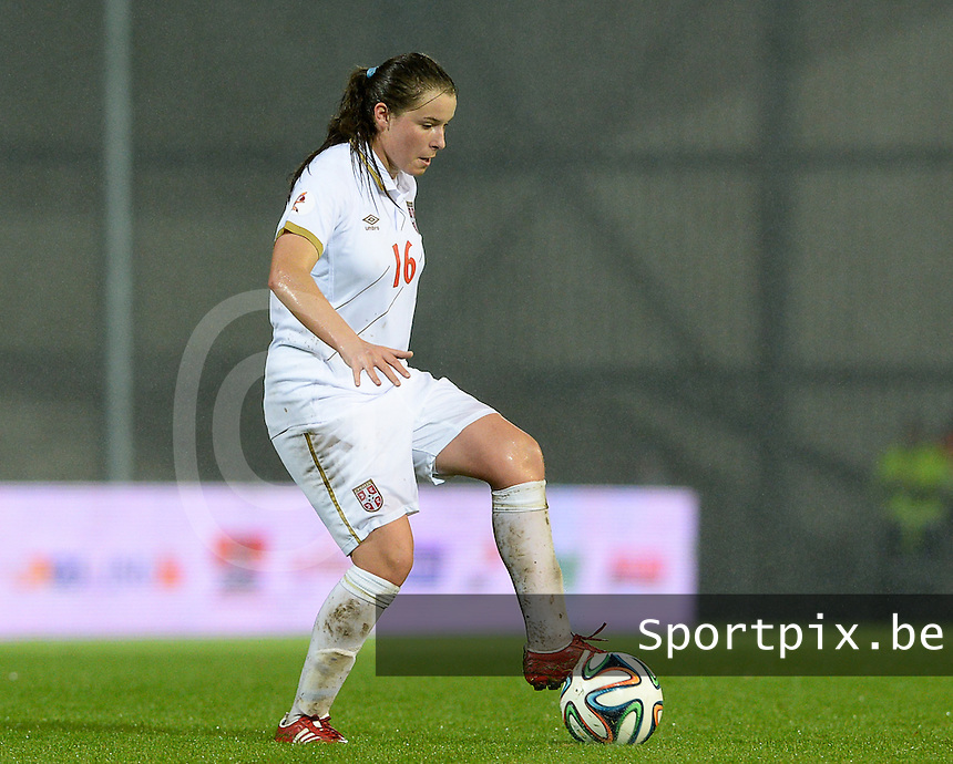 20151130 - LEUVEN ,  BELGIUM : Serbian Dina Blagojevic pictured during the female soccer game between the Belgian Red Flames and Serbia , the third game in the qualification for the European Championship in The Netherlands 2017  , Monday 30 November 2015 at Stadion Den Dreef  in Leuven , Belgium. PHOTO DAVID CATRY