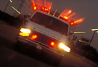 Emergency, Ambulance, Trauma, special effect illustrating speed, urgency, streaked lights, vehicle, transportation, medicine, medical.