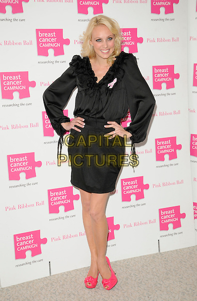 CAMILLA DALLERUP .Attending the Pink Ribbon Ball at the Dorchester Hotel, Park Lane, London, England, UK, October 10th 2009..full length  black dress pink shoes ruffles ruffle peep toe hands on hips skirt blouse top tucked in .CAP/CAN.©Can Nguyen/Capital Pictures.