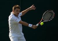 Stanislas Wawrinka (SUI) (19) against Martin Vassallo Arguello (ARG)  in the second round of the gentlemen's singles. Wawrinka beat Arguello 6-3 6-2 6-2..Tennis - Wimbledon - Day 4 - Thur 25th June 2009 - All England Lawn Tennis Club  - Wimbledon - London - United Kingdom..Frey Images, Barry House, 20-22 Worple Road, London, SW19 4DH.Tel - +44 20 8947 0100.Cell - +44 7843 383 012