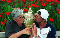 GORAN IVANISEVIC AND HIS DAD (SRDJAN) (CROATIA) MENS CHAMPION 2001 CELEBRATE WITH TROPHY WIMBLEDON TENNIS CHAMPIONSHIPS 2001 PHOTO ROGER PARKER FOTOSPORTS INTERNATIONAL