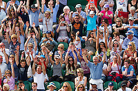 26-06-13, England, London,  AELTC, Wimbledon, Tennis, Wimbledon 2013, Day three, The wave in court 2<br /> <br /> <br /> <br /> Photo: Henk Koster