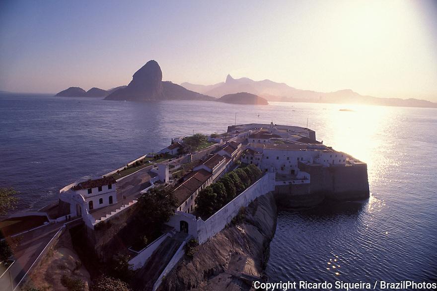 Santa Cruz fortress, ( Fortaleza de Santa Cruz da Barra ) in Niteroi city, entrance of Guanabara Bay -  Sugar Loaf and Rio de Janeiro mountains in the background, Brazil.
