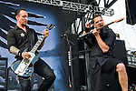 Michael Poulsen and Anders Kjølholm of Volbeat perform during the 2013 Rock On The Range festival at Columbus Crew Stadium in Columbus, Ohio.