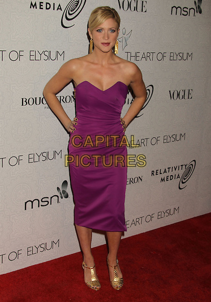BRITTANY SNOW.Attending The Art of Elysium's 3rd Annual Black Tie Charity Gala Heaven at the Beverly Hilton, Beverly Hills, CA, USA, January 16th 2010. .arrivals full length strapless purple dress hands on hips gold t-bar sandals open toe.CAP/ADM/MJ.©Michael Jade/Admedia/Capital Pictures