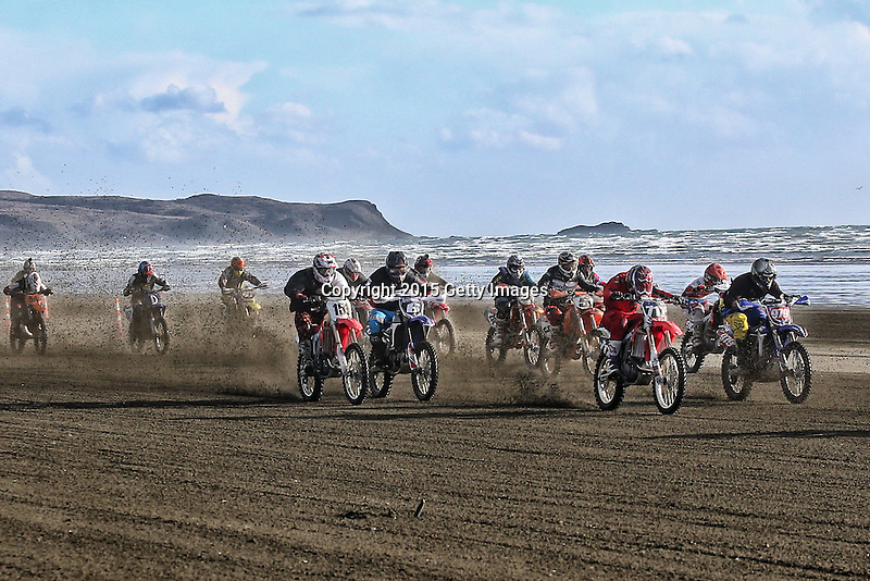 INVERCARGILL, NEW ZEALAND - NOVEMBER 27:  Motorcyclists race in  the Indian Motorcycle NZ Beach Racing Champs during the 10th Anniversary of the 2015 Burt Munro Challenge at Oreti Beach on November 27, 2015 in Invercargill, New Zealand.  (Photo by Dianne Manson/Getty Images) *** Local Caption ***