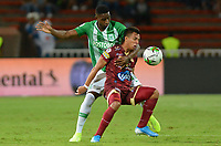 MEDELLIN - COLOMBIA, 29-09-2019: Andres Reyes del Nacional disputa el balón con Alex Castro de Tolima durante partido por la fecha 13 de la Liga Águila II 2019 entre Atlético Nacional y Deportes Tolima jugado en el estadio Atanasio Girardot de la ciudad de Medellín. / Andres Reyes of Nacional struggles the ball with Alex Castro of Tolima during match for the date 13 as part of Aguila League II 2019 between Atletico Nacional and Deportes Tolima played at Atanasio Girardot stadium in Medellín city. Photo: VizzorImage / Leon Monsalve / Cont