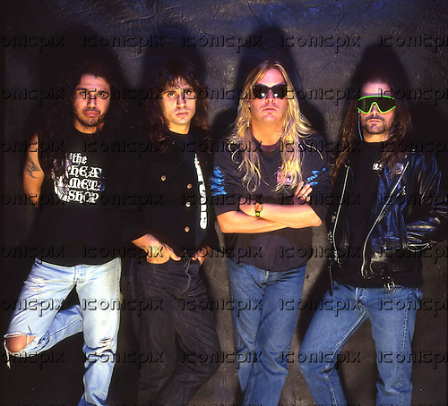 Slayer - L-R: Tomn Araya, Dave Lombardo, Jeff Hanneman, Kerry King - photosession at the end of the Clash of The Titans Tour  in London UK - 15 Oct 1990.  Photo credit: Tony Mottram/IconicPix