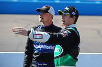 Apr 17, 2009; Avondale, AZ, USA; NASCAR Nationwide Series driver Carl Edwards (right) talks with Daryl Harr during qualifying prior to the Bashas Supermarkets 200 at Phoenix International Raceway. Mandatory Credit: Mark J. Rebilas-